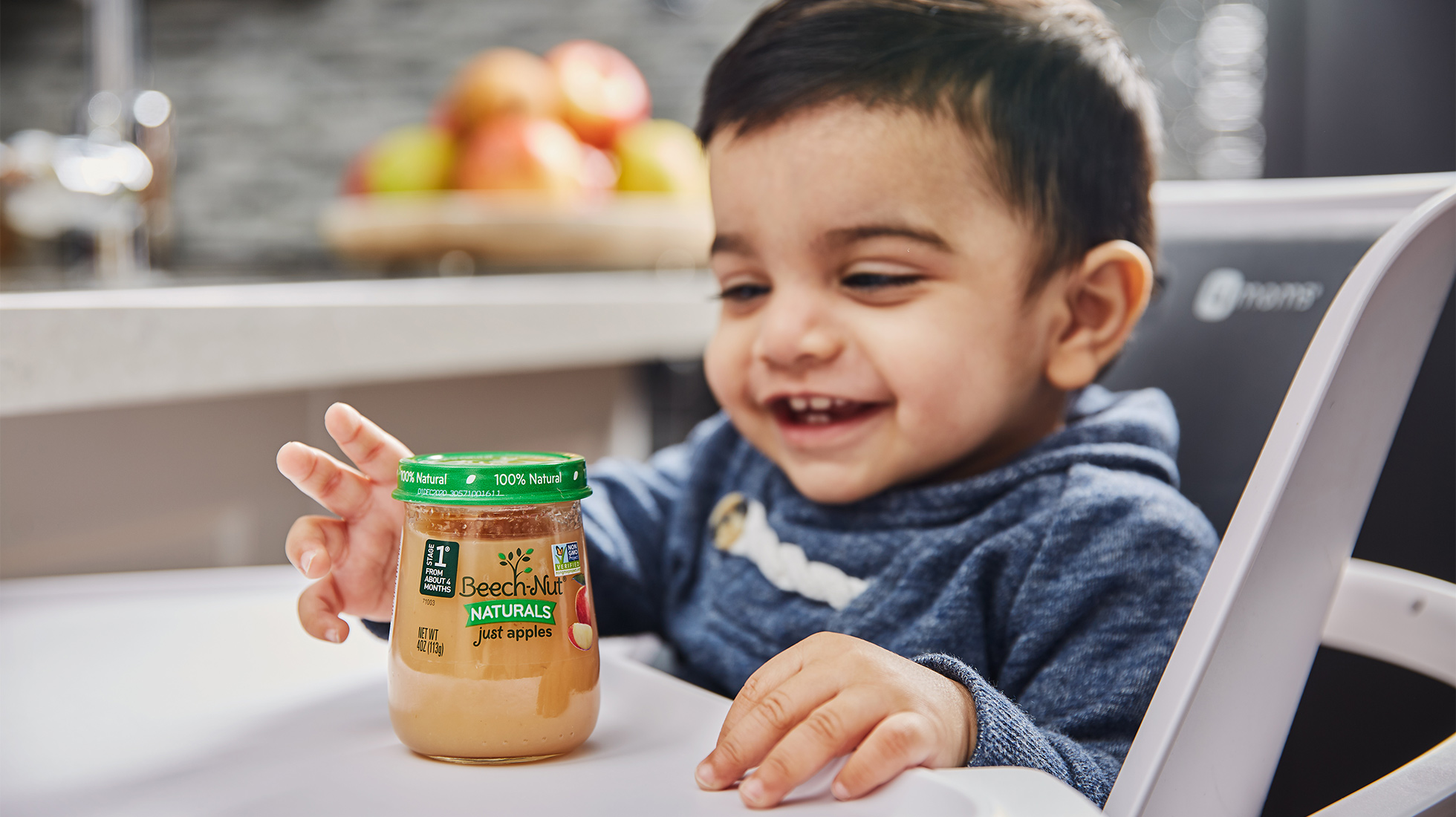 Infant enjoying Beech Nut Natural baby food