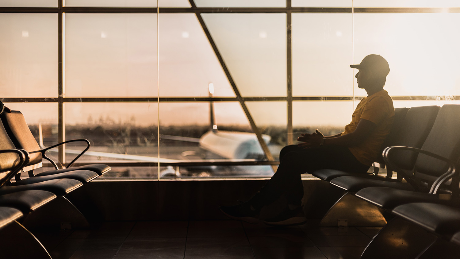 Person sitting at airport gate
